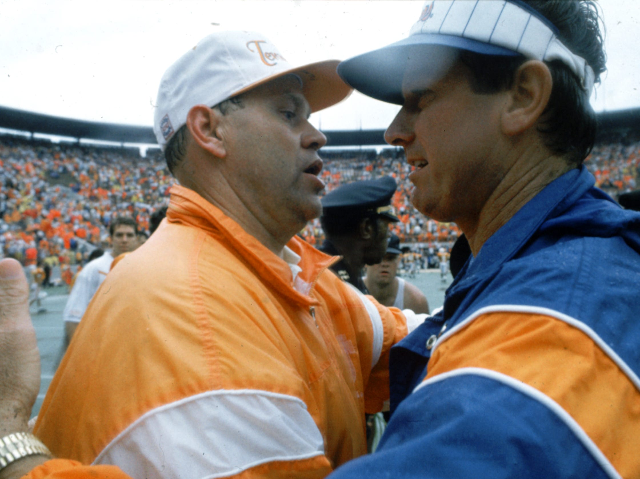 University of Tennessee football Coach Phillip Fulmer shares a pat on the back with then University of Florida Coach Steve Spurrier, December 20, 1992. Fulmer lost to Spurrier again Saturday 110108 as UT fell to the University of South Carolina 27-6.