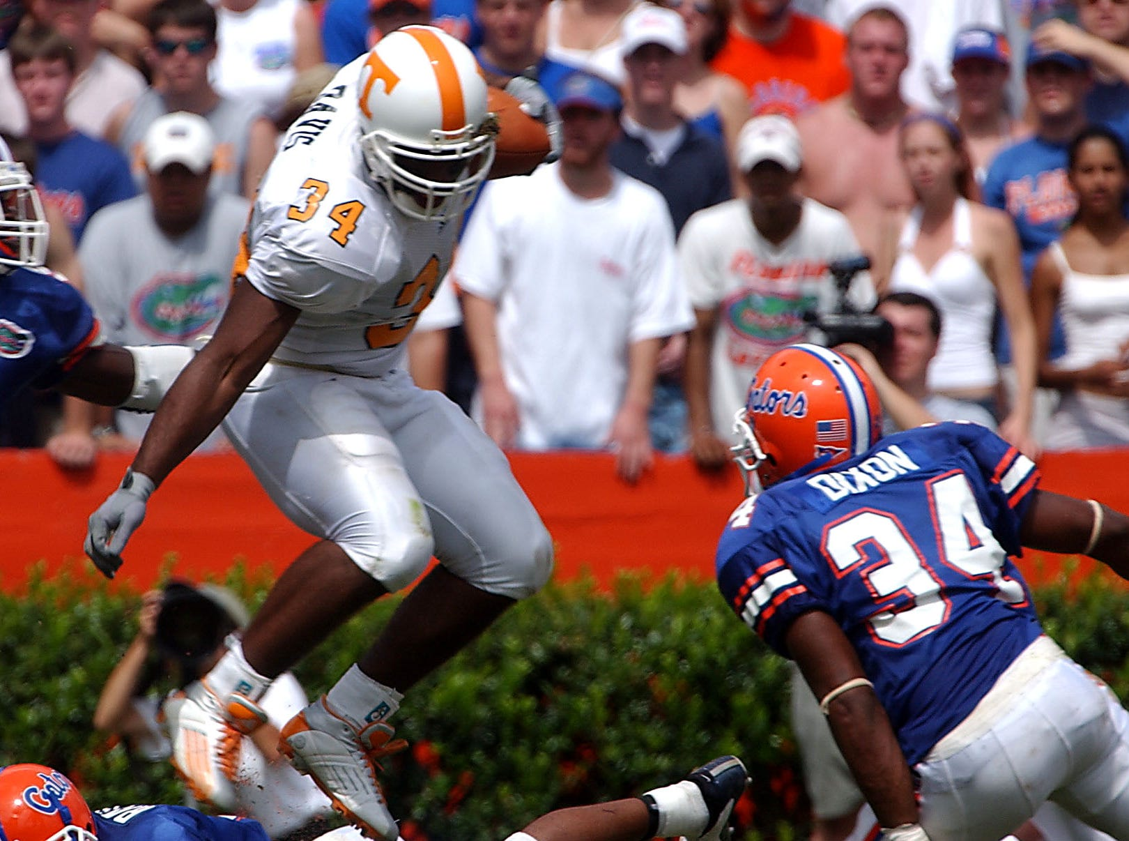 Tennessee's (34) Jabari Davis leaps over several Florida defenders during Saturday's win over the Gators.  Tennessee beat the Florida Gators 24-10.  Florida players are (34) Daryl Dixon and (9) Matt Kynes. 9/20/2003