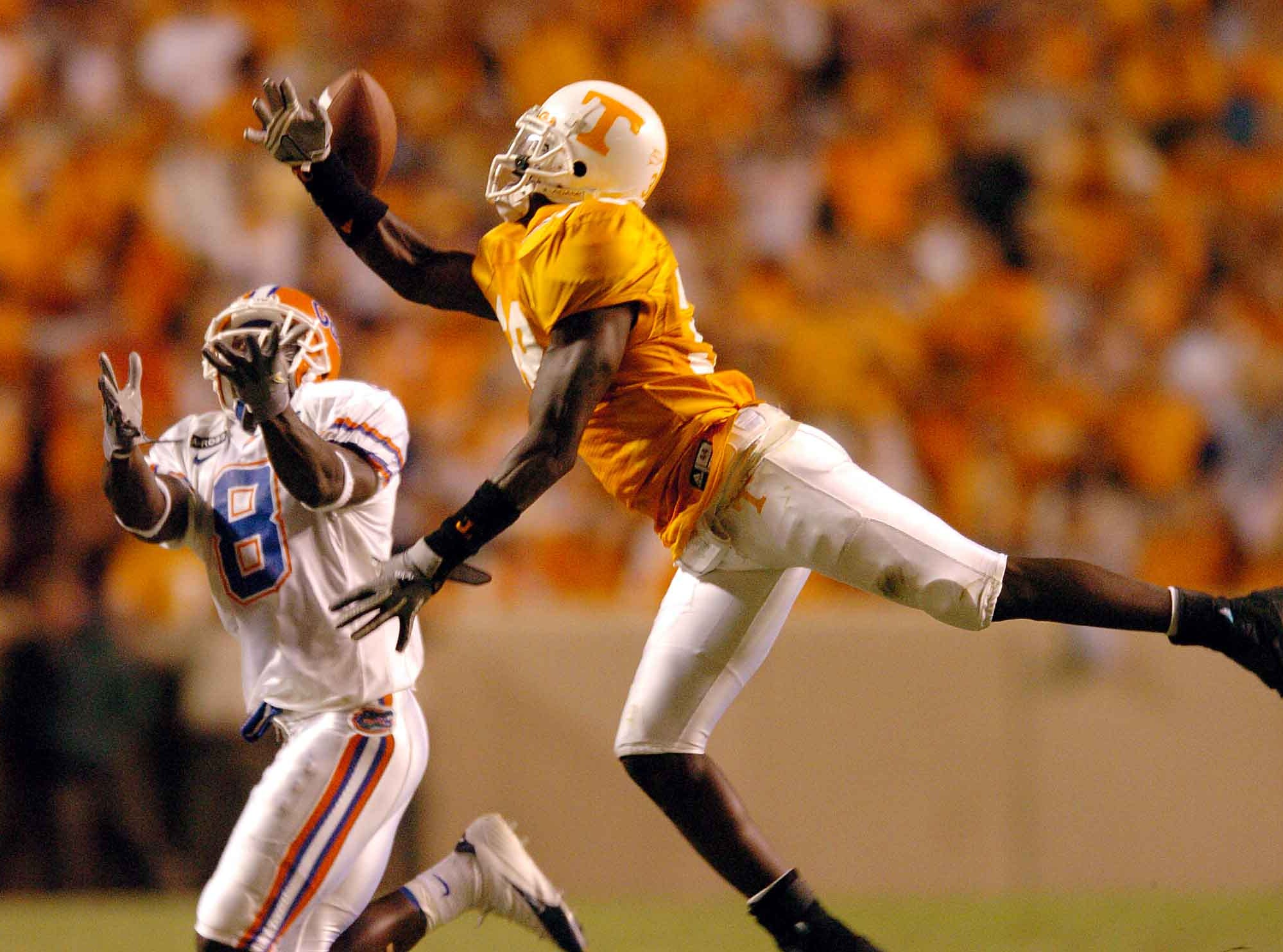 Tennessee safety Brandon Johnson misses a pass that Florida wide receiver Chad Jackson catches for a 81-yard touchdown during the fourth quarter Saturday at Neyland Stadium.     9/18/2004