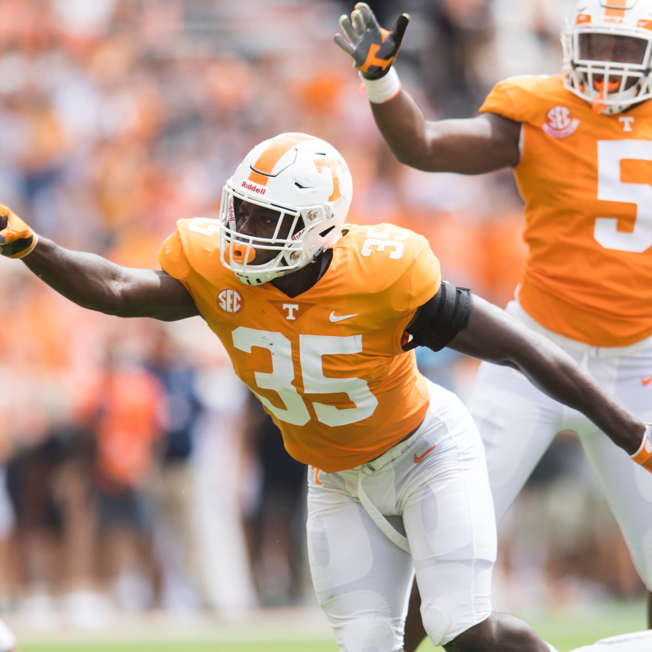 Tennessee linebacker Daniel Bituli (35) and lineman Kyle Phillips (5) celebrate after Bituli sacked UTEP quarterback Kai Locksley (1) on Saturday, September 15, 2018.