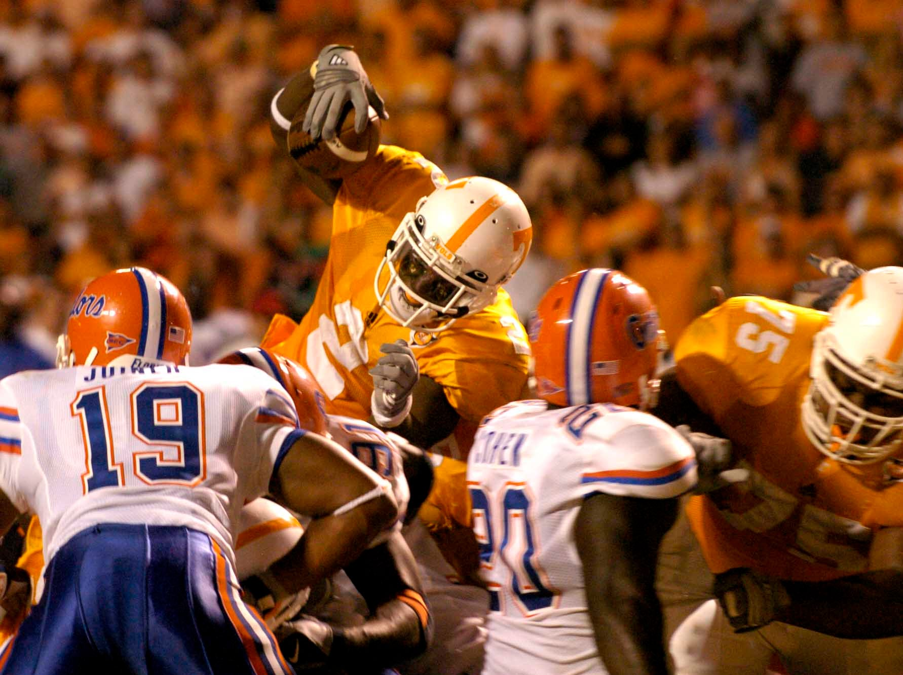 Tennessee's Montario Hardesty (2) dives over the Florida line to score a touchdown in the third quarter Saturday night in Neyland Stadium.