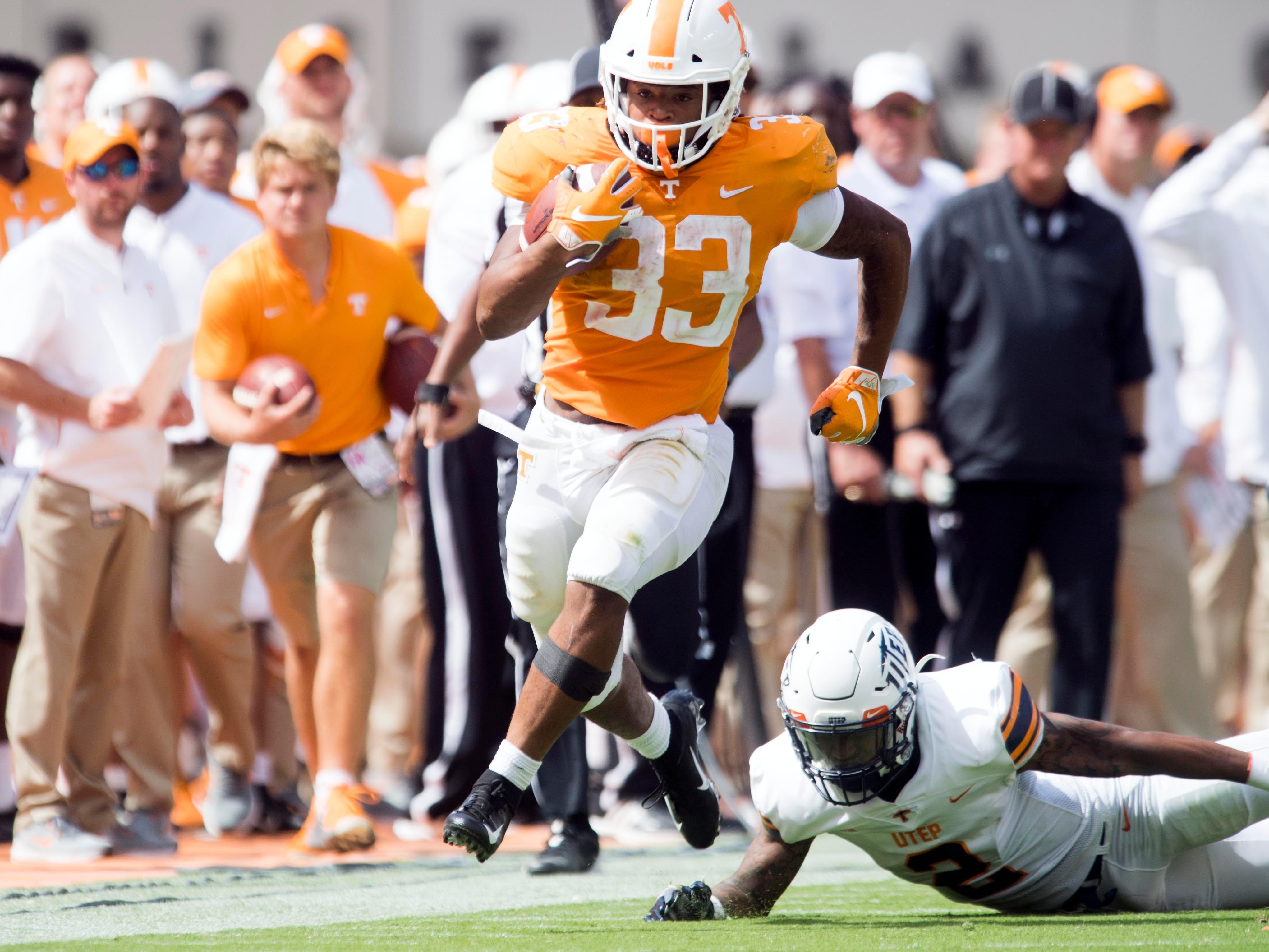 Tennessee running back Jeremy Banks (33) gets past UTEP defensive back Michael Lewis (2) on Saturday, September 15, 2018.
