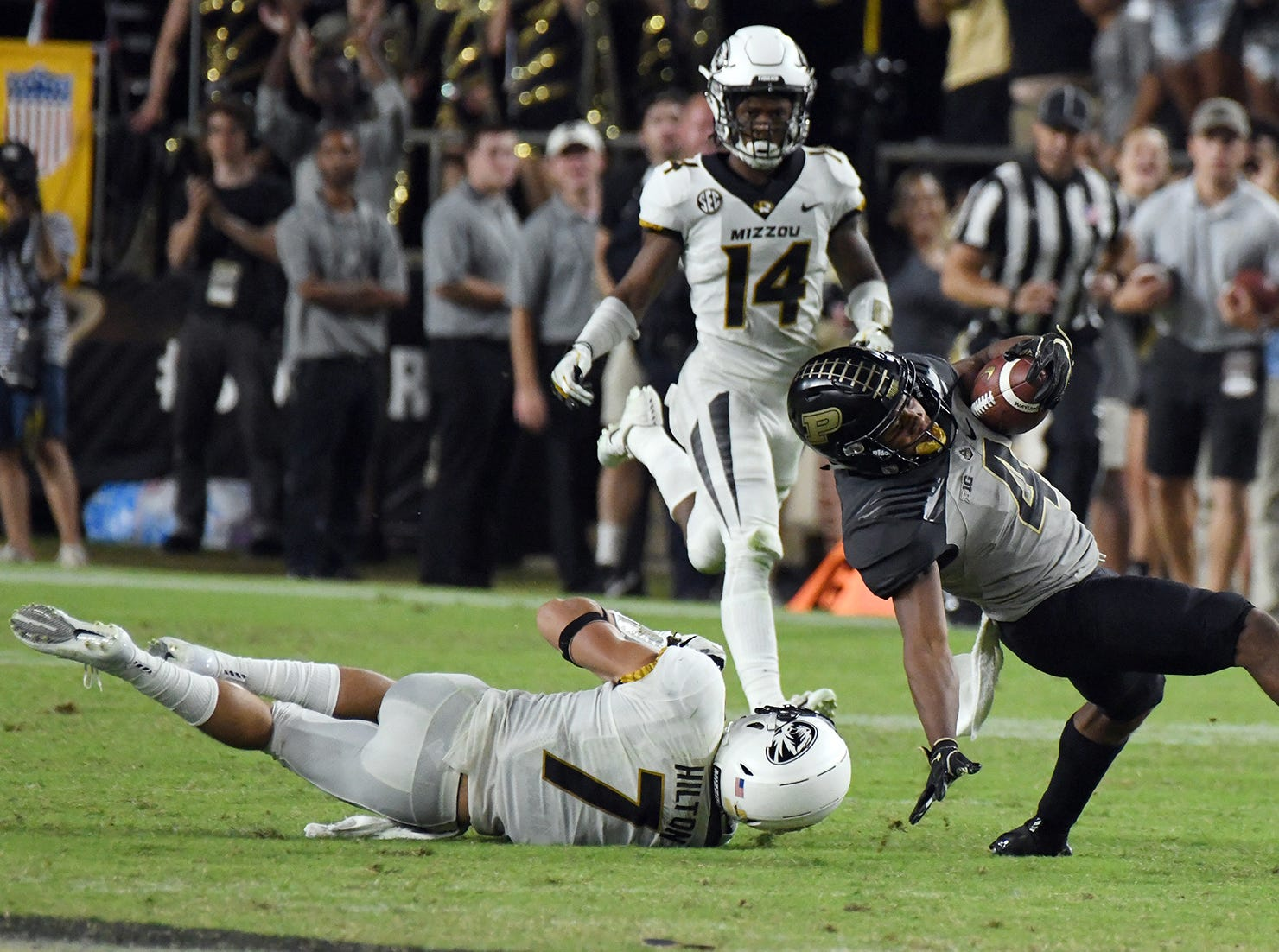 Rondale Moore of Purdue slips past Cam Hilton of Missouri in the second half Saturday, September 15, 2018, in West Lafayette. Purdue lost 40-37 on a Missouri field goal as time expired.