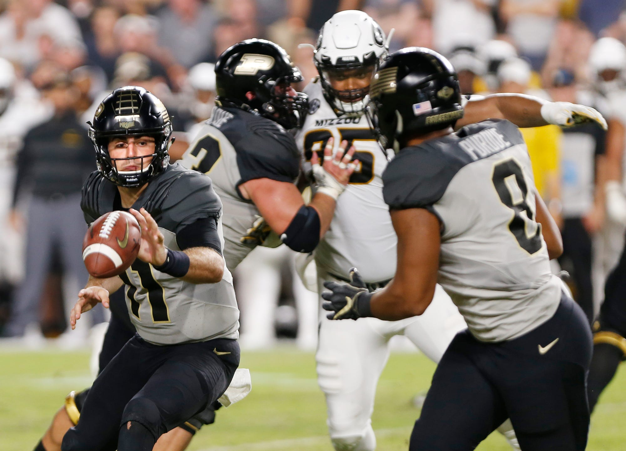 Purdue quarterback David Blough with an option pitch to Markell Jones in the second half Saturday, September 15, 2018, in West Lafayette. Purdue lost 40-37 on a Missouri field goal as time expired. Missouri defeated Purdue 40-37 on Tucker McCann's field goal as time expired.