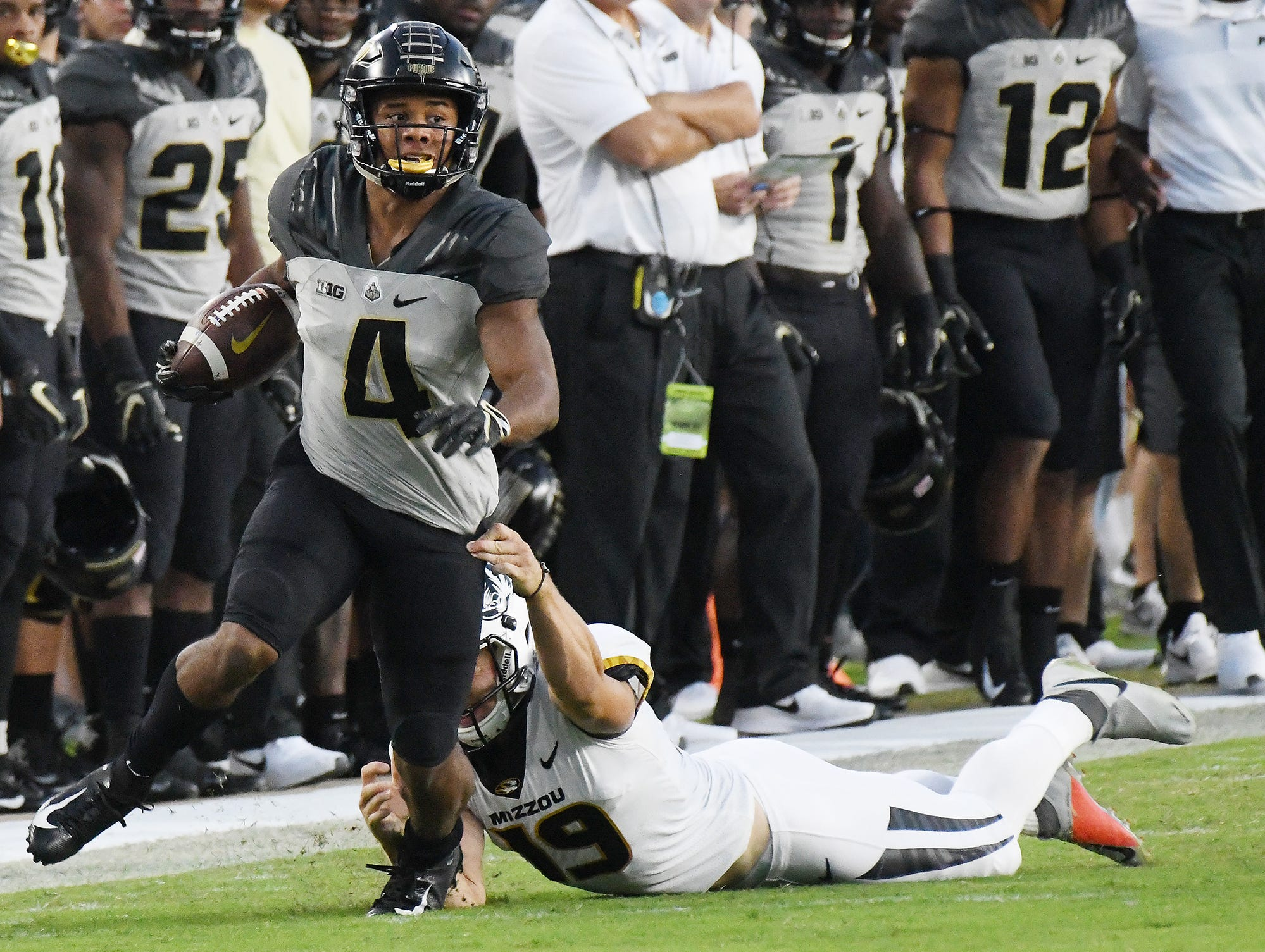 Rondale Moore of Purdue slips through the hands of Tucker McCann of Missouri on a first half return Saturday, September 15, 2018, in West Lafayette. Missouri defeated Purdue 40-37 on Tucker McCann's field goal as time expired.