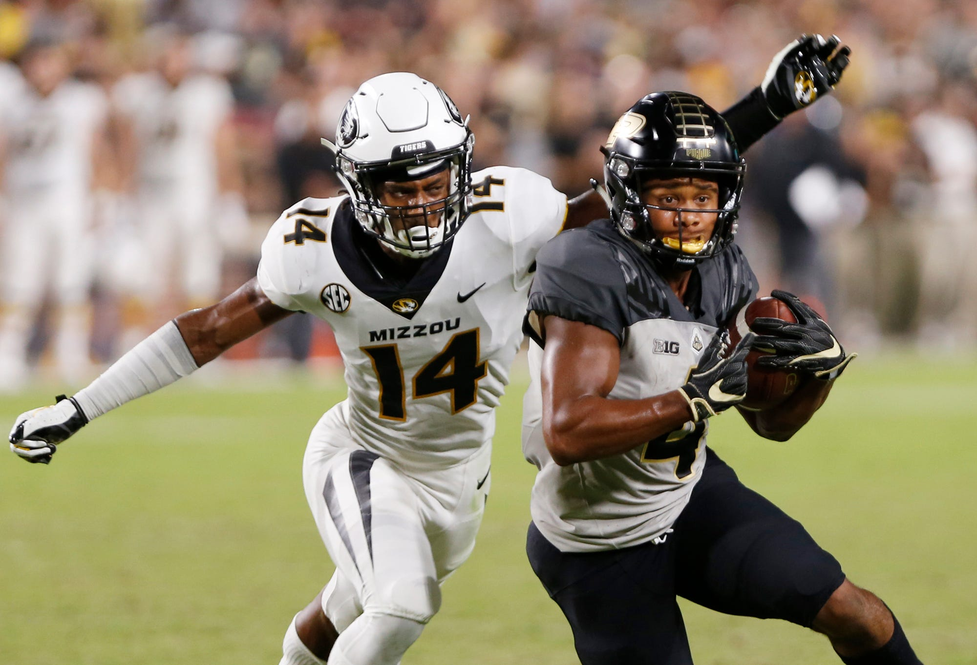 Rondale Moore of Purdue with a pass reception in front of Adam Sparks of Missouri in the second half Saturday, September 15, 2018, in West Lafayette. Purdue lost 40-37 on a Missouri field goal as time expired. Missouri defeated Purdue 40-37 on Tucker McCann's field goal as time expired.