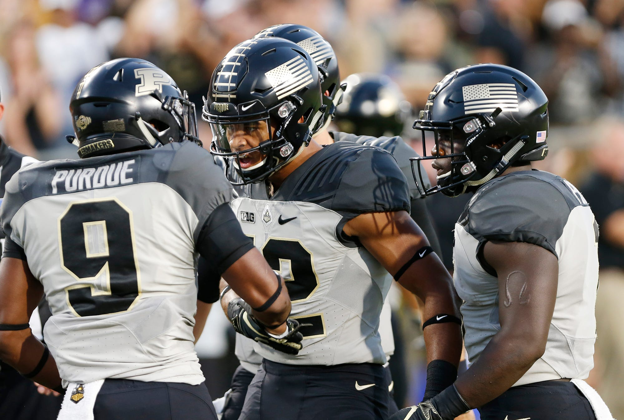 Terry Wright, left, of Purdue celebrates with teammates Jared Sparks and D. J. Knox after his touchdown reception in the first against Missouri Saturday, September 15, 2018, in West Lafayette.