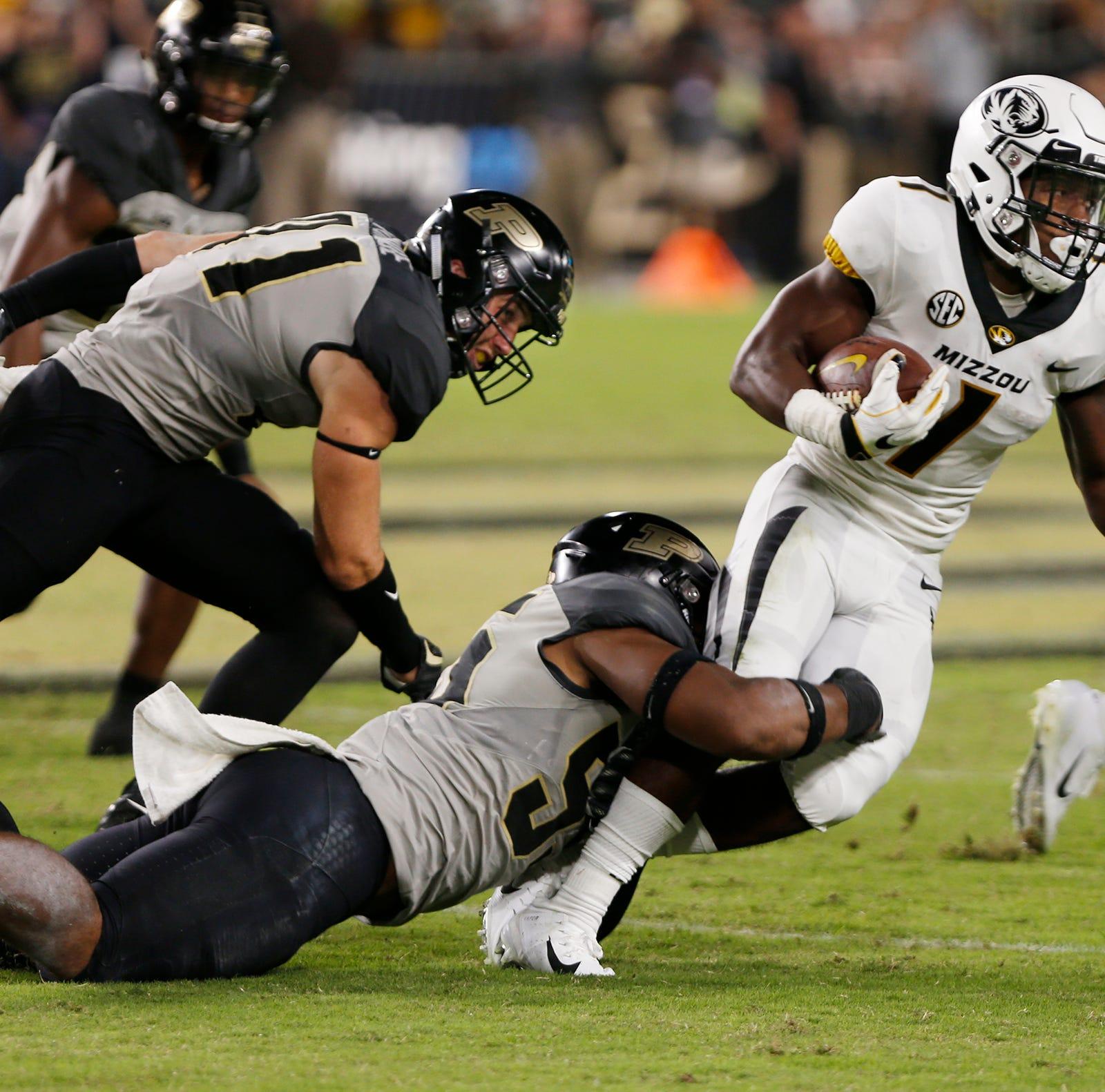 Purdue linebacker Derrick Barnes brings down Khmari Thompson of Missouri Saturday, September 15, 2018, in West Lafayette. Purdue lost 40-37 on a Missouri field goal as time expired.
