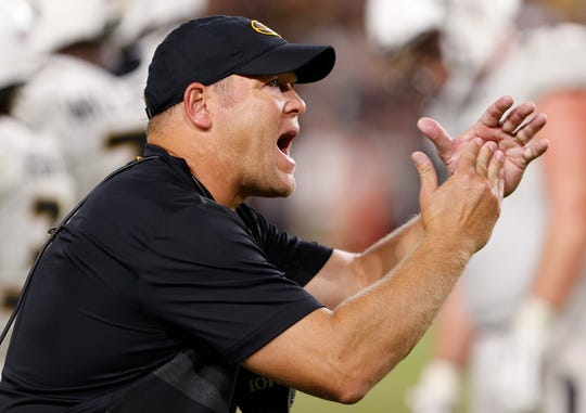 Missouri head coach Barry Odom calls for a timeout with three second remaining in the game against Purdue Saturday, September 15, 2018, in West Lafayette. Purdue lost 40-37 on a field goal by Missouri kicker Tucker McCann as time expired.