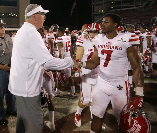 UL linebacker Ferrod Gardner shakes hands with Mississippi State coach Joe Moorhead after the Ragin' Cajuns loss to the Bulldogs in September.