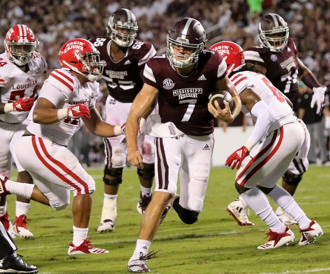 Mississippi State quarterback Nick Fitzgerald (7) sprints into the end zone for a touchdown between Louisiana-Lafayette defenders Bennie Higgins (15) and Corey Turner (6) during the first half of their NCAA college football game on Saturday, Sept. 15, 2018, in Starkville, Miss. (AP Photo/Jim Lytle)