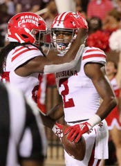 """UL wide receiver Jarrod """"Bam"""" Jackson (left) celebrates a touchdown by wide receiver Ja'Marcus Bradley during a game against Mississippi State on Sept. 15, 2018."""