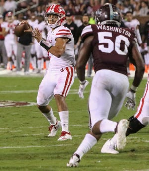 UL quarterback Andre Nunez prepares to throw on his touchdown pass to Ja'Marcus Bradley in last Saturday night's 56-10 loss at No. 16 Mississippi State.