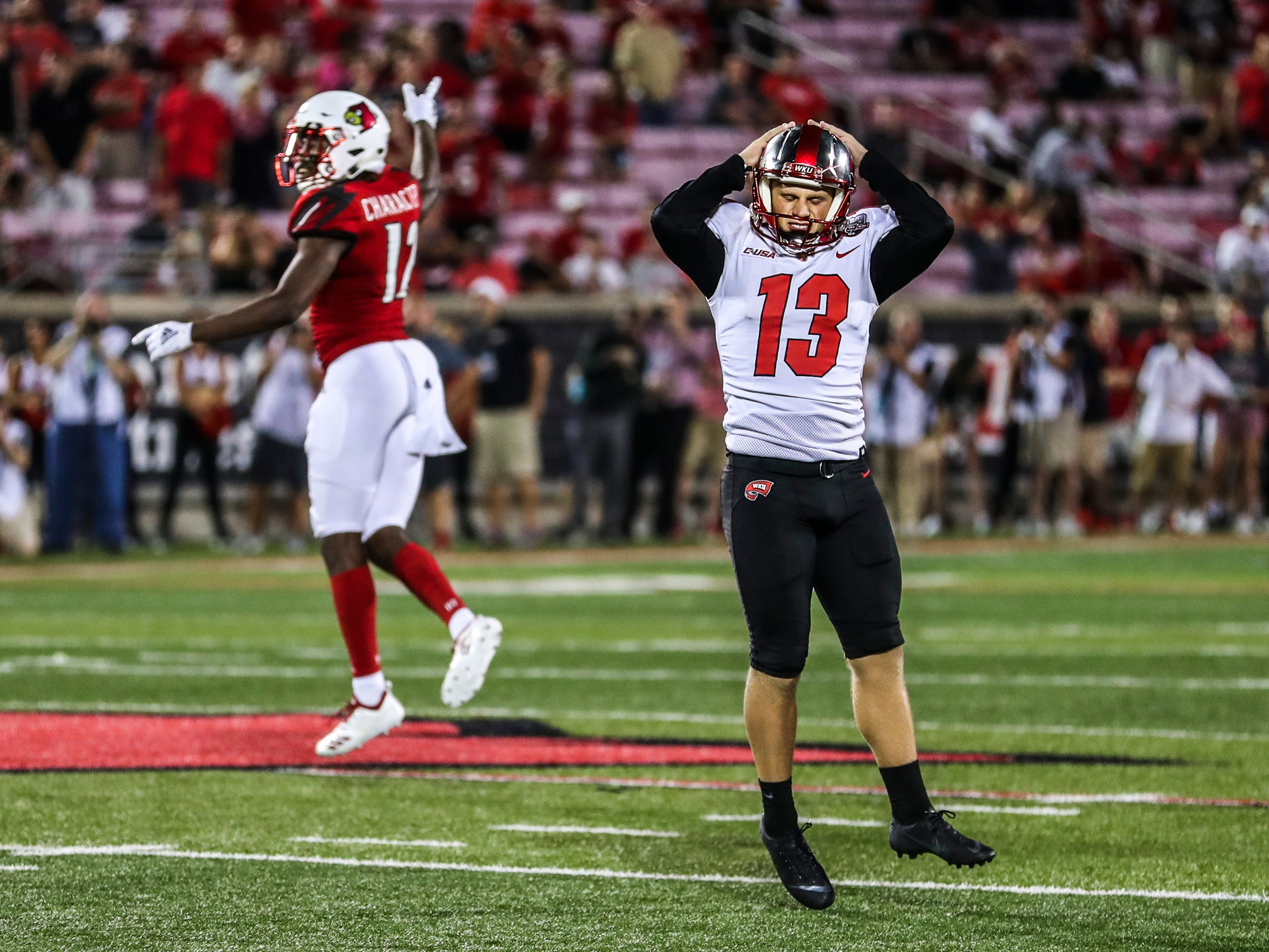 Western Kentucky kicker Ryan Nuss reacts with disappointment after his last second field goal attempt missed as Louisville squeaked by the Hilltoppers 20-17 Saturday, Sept. 15, 2018.