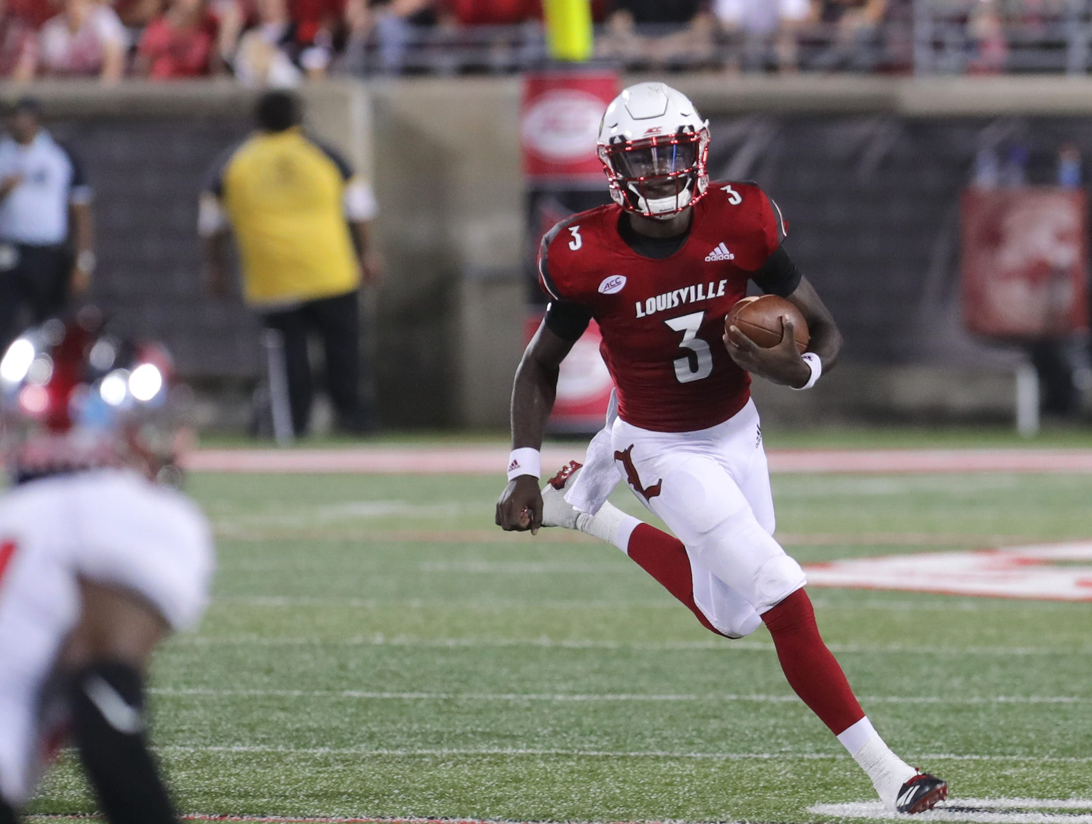 Louisville's Malik Cunningham runs for some positive yards.  