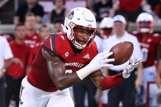 Louisville's C.J. Avery (9) intercepts a WKU pass during their game at Cardinal Stadium.Sep. 15, 2018