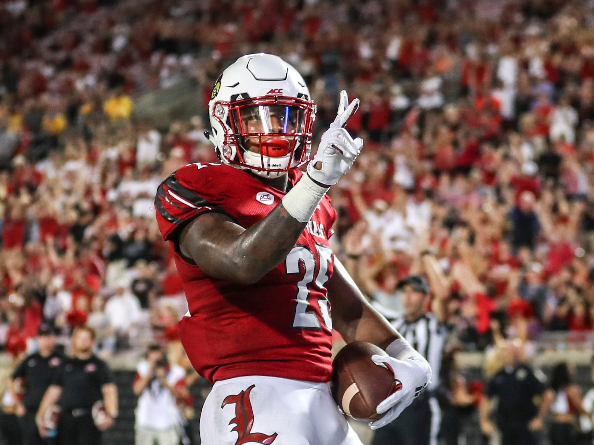 Louisville's Dae Williams gets his second touchdown of the game put the Cardinals ahead of Western Kentucky 20-17 late in the fourth quarter Saturday, Sept. 15, 2018.