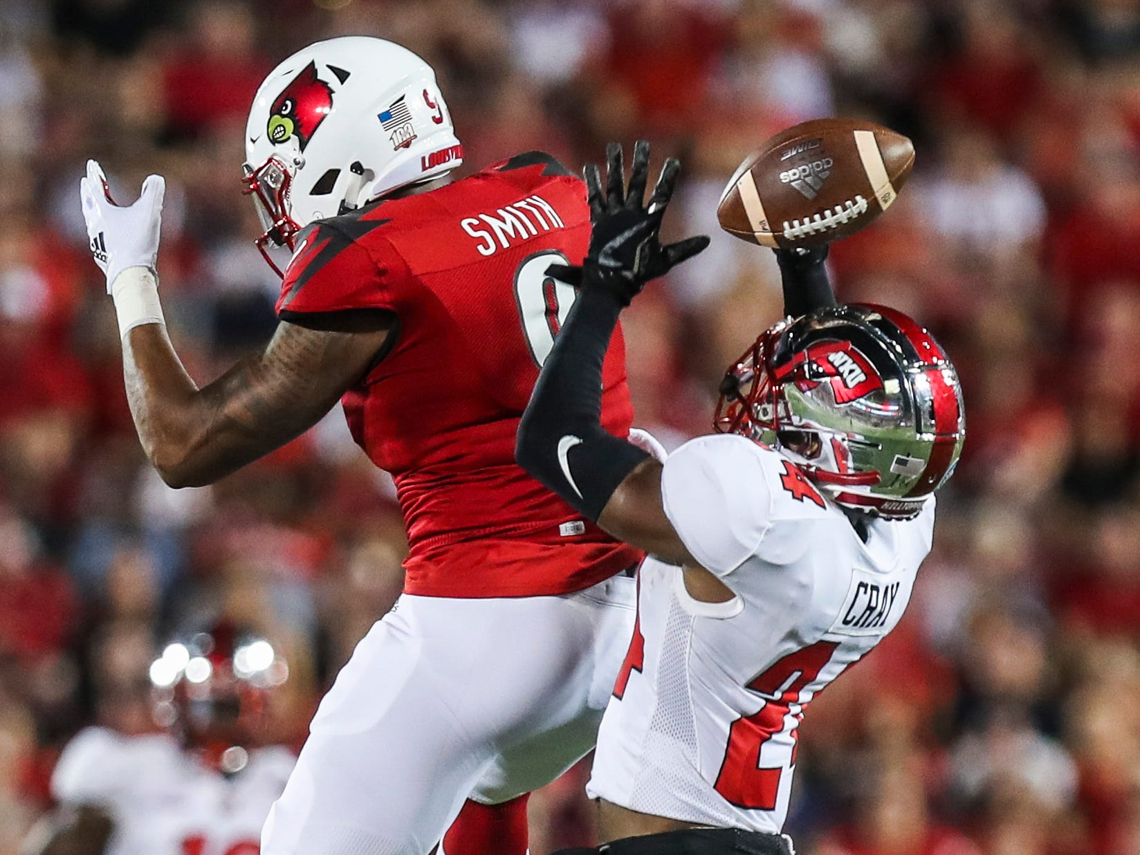 Western Kentucky's Deandre Farris almost intercepted this pass meant for Louisville's Jaylen Smith as the Toppers went up 14-0 on the Cardinals Saturday, Sept. 15, 2018.