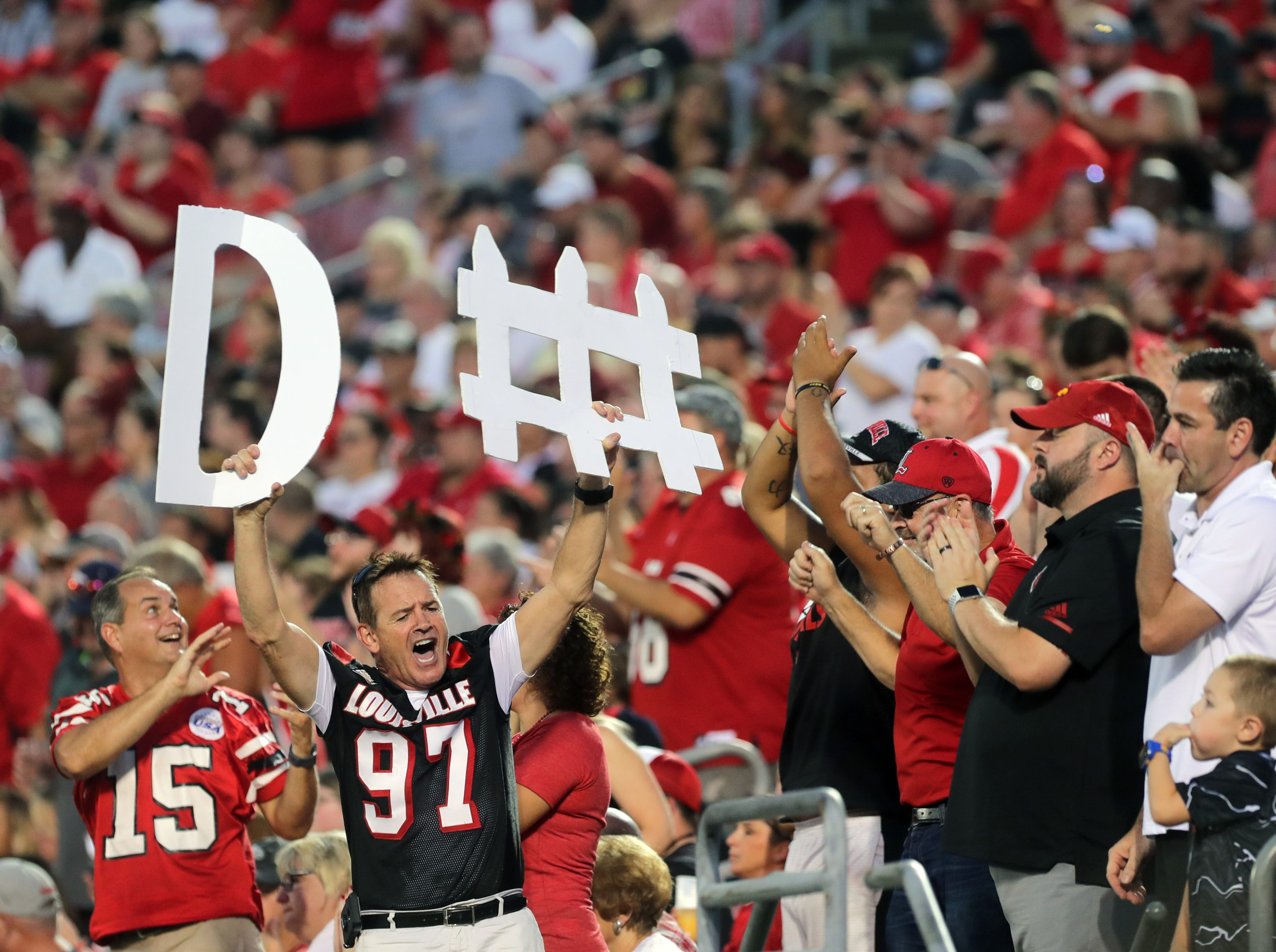 Louisville fans cheer on the team. 