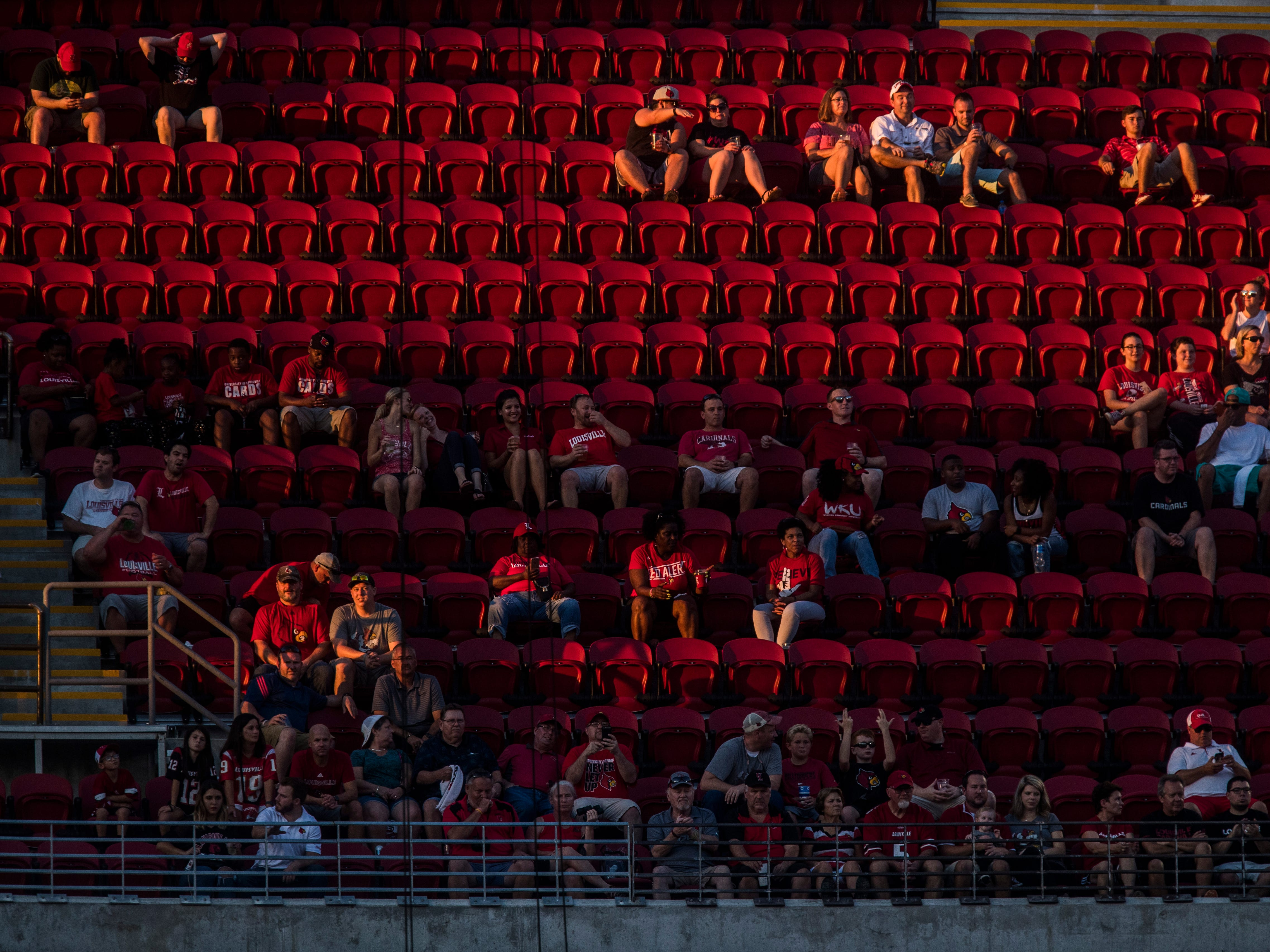 Fans watch the game between Louisville and Western Kentucky at Cardinal Stadium Saturday, Sept. 15, 2018.