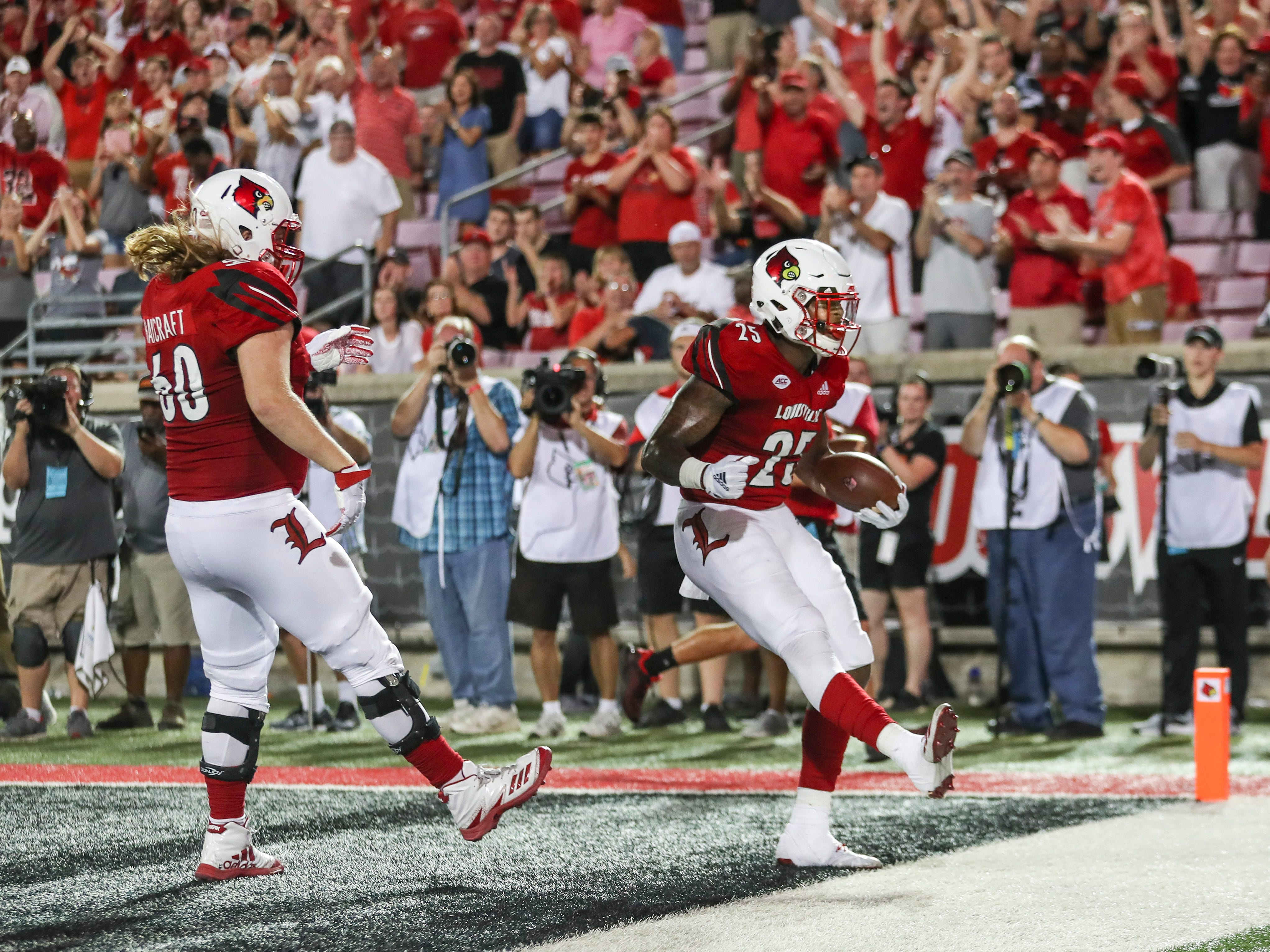 Louisville's Dae Williams celebrates as he scores a touchdown to bring the Cardinals close to Western Kentucky after trailing by two touchdowns through the early third quarter. It was Louisville's first touchdown of the game. Saturday, Sept. 15, 2018.