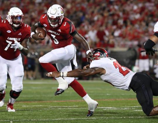 Malik Cunningham eludes a tackle in Louisville's game vs. WKU.