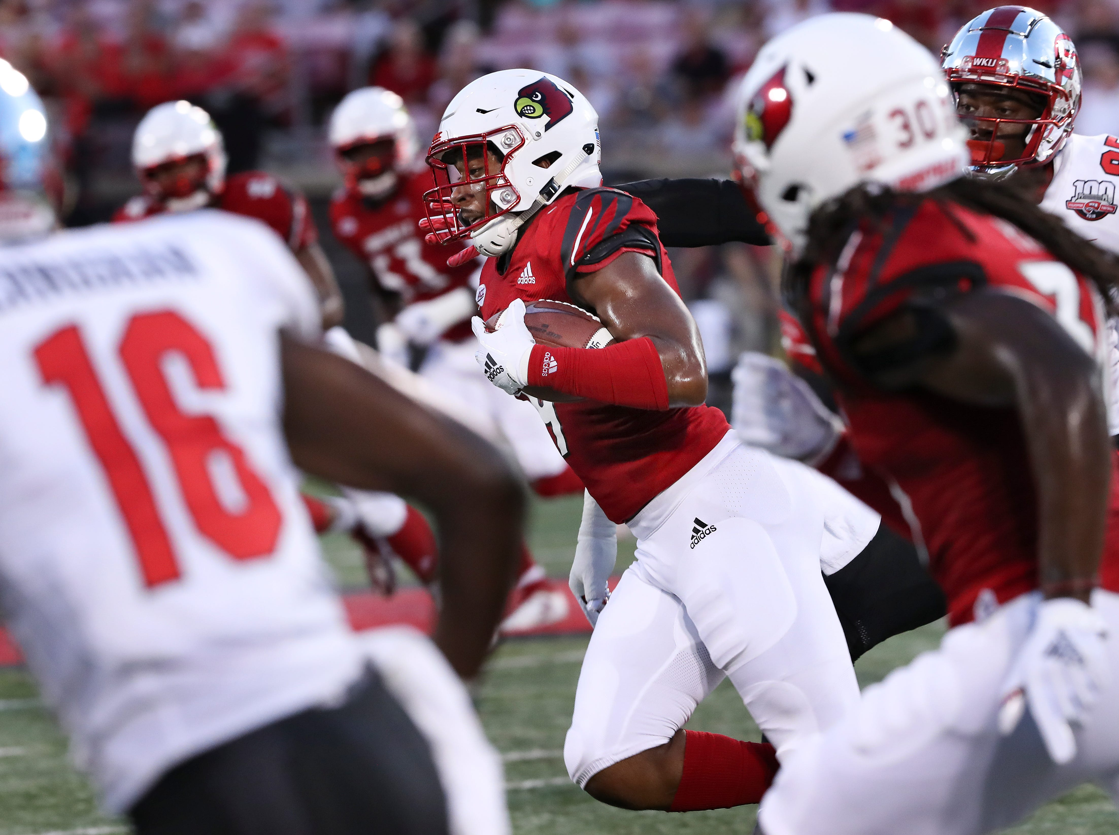 Louisville's C.J. Avery (9) runs back an intercepted WKU pass to give U of L possession during their game at Cardinal Stadium.