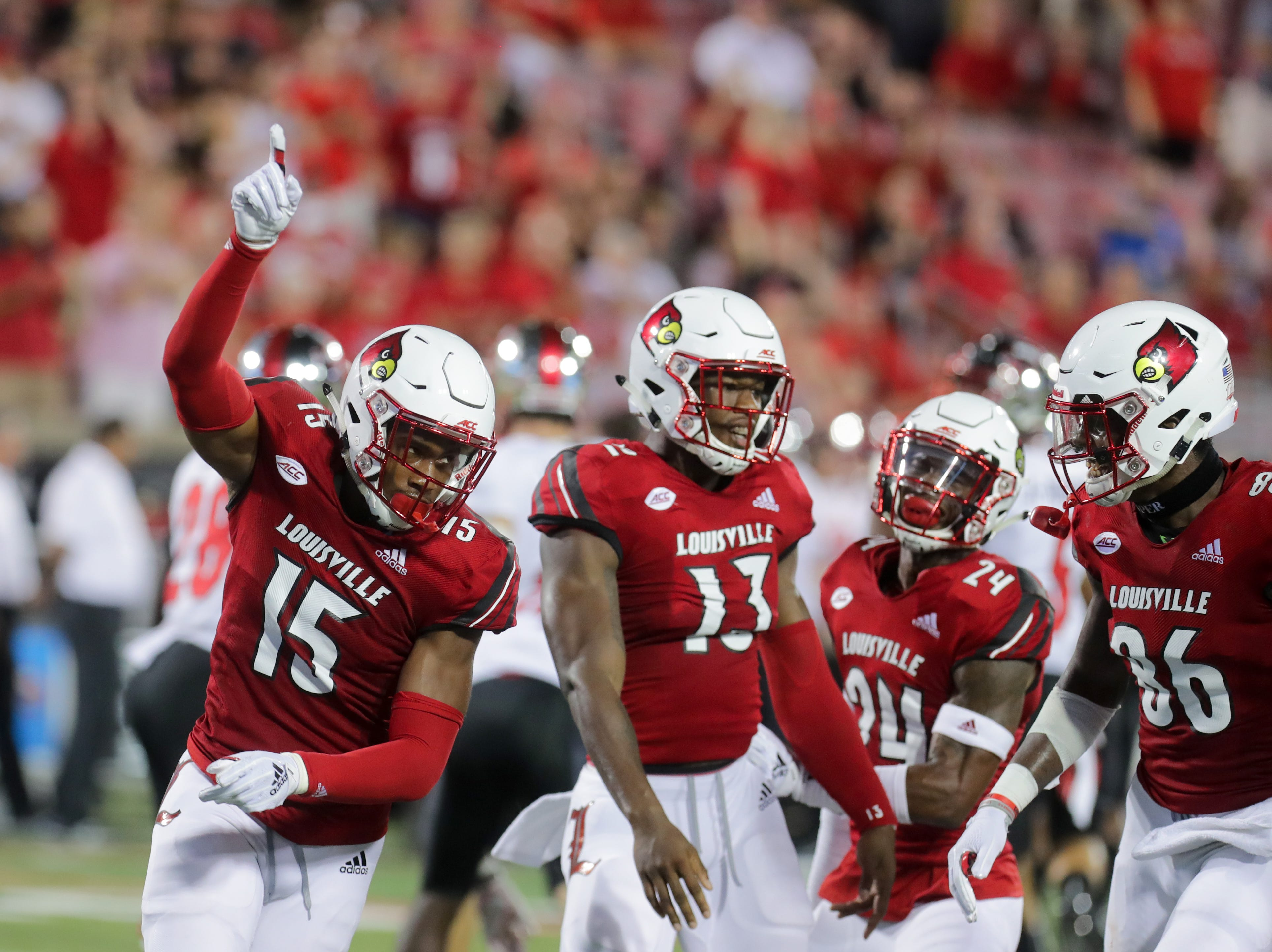 Louisville's Quen Head celebrates with the rest of the defense. 