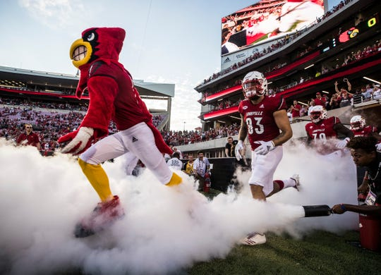 The Louisville Cardinals run out of the new stadium addition before the game against Western Kentucky Saturday, Sept. 15, 2018.