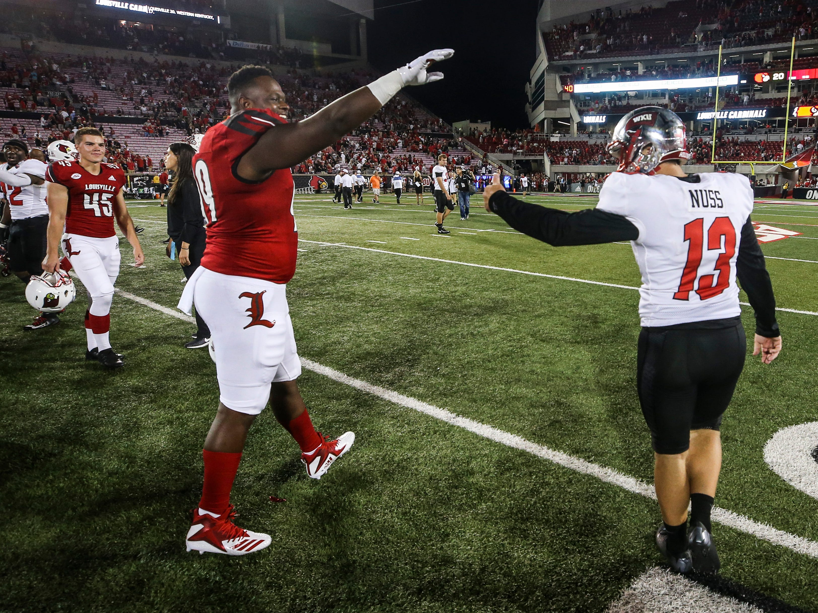 Louisville's Allen Love says 'Goodbye' as he and Western Kentucky kicker Ryan Nuss exchange words after the Cardinals finally defeated the Hilltoppers 20-17 after Nuss's last field goal attempt missed Saturday, Sept. 15, 2018.