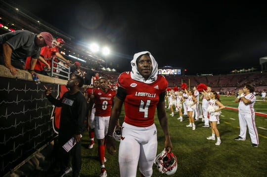 Jawon Pass walks off the field after Louisville's win over WKU.