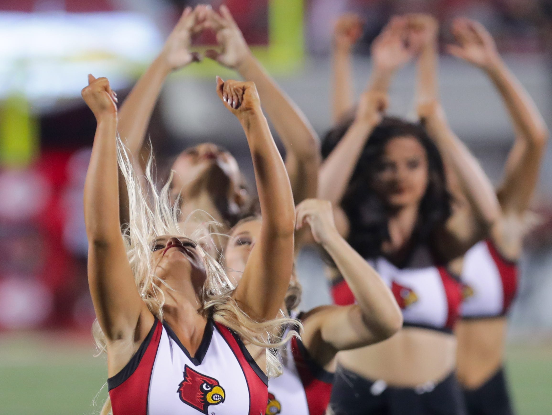 The Louisville Ladybirds entertain the crowd during a performance in the 3rd quarter. 