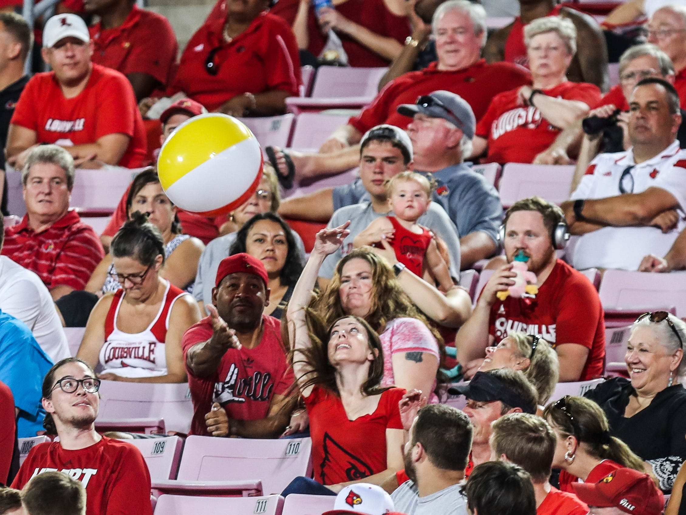Fans in the seats found some side entertainment with a beachball as the Western Kentucky Hilltoppers went up 14-3 on the Cardinals in the first half Saturday, Sept. 15, 2018.