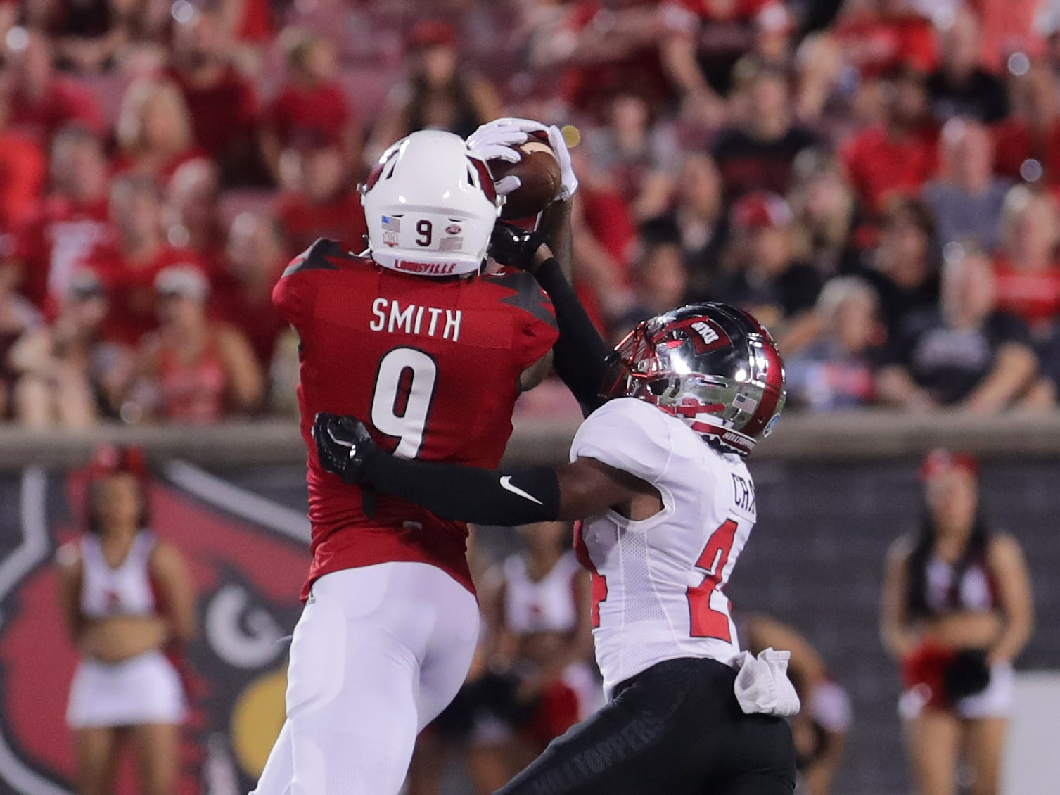Louisville's Jaylen Smith grabs the catch for a first down.  