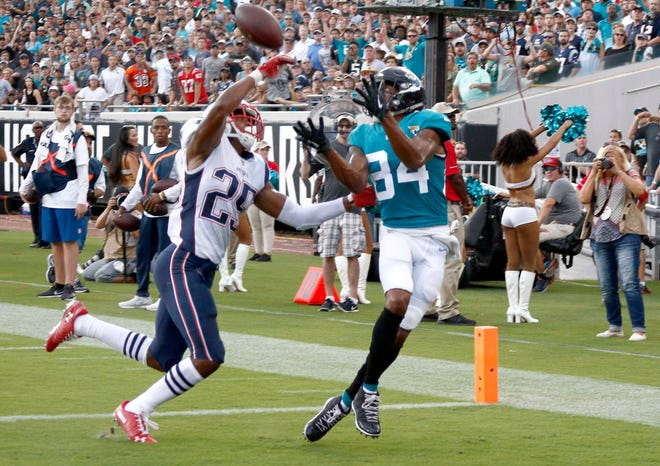 Sep 16, 2018; Jacksonville, FL, USA; Jacksonville Jaguars wide receiver Keelan Cole (84) makes a touchdown grab in front of New England Patriots defensive back Eric Rowe (25) during the first quarter at TIAA Bank Field. Mandatory Credit: Reinhold Matay-USA TODAY Sports