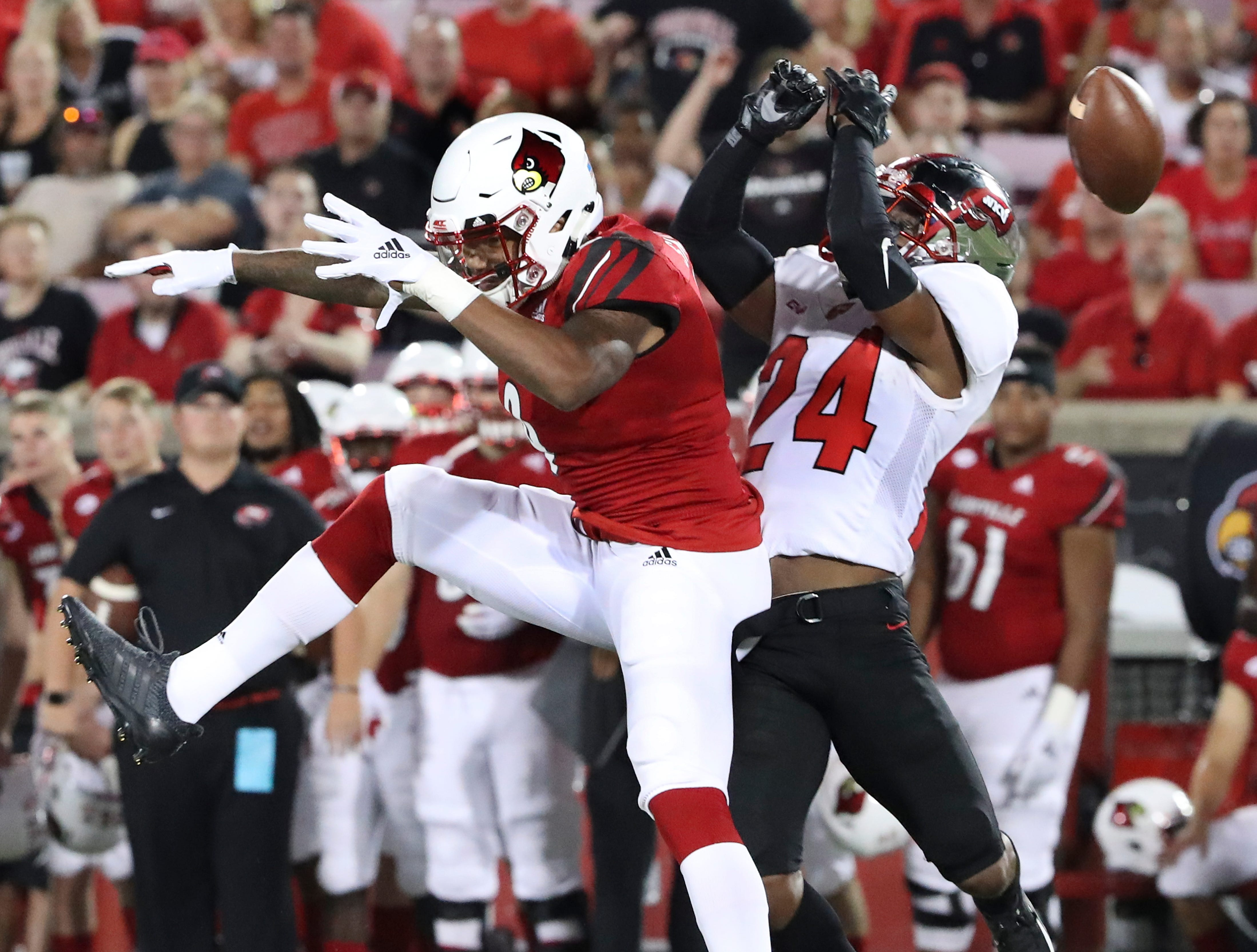 Louisville's Jaylen Smith (9) missed a pass that was almost intercepted by WKU's Roger Cray (24) during their game at Cardinal Stadium.
