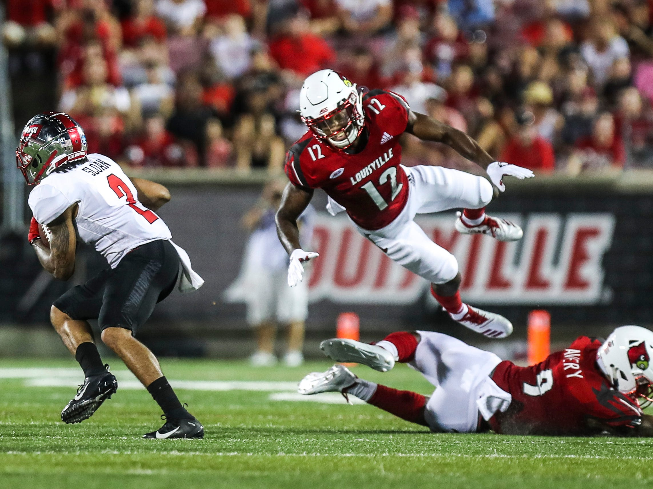 Western Kentucky's Jacquez Sloan outjukes  Louisville's Marlon Character as the Toppers went up 14-0 on the Cardinals Saturday, Sept. 15, 2018.