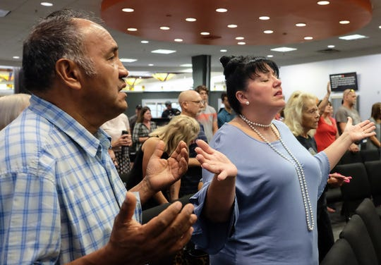 Congregants worshiped Sunday in the new space for Impact Church, now located in the Lansing Mall. The church started in Grand Ledge a few years ago with a group of about 20 people.