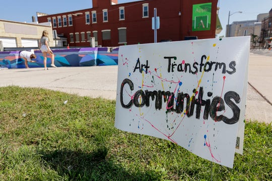 A sign bears the slogan of Art Slam near the public mural project at 9th and Jay Street Saturday, September 15, 2018, in Manitowoc, Wis. Josh Clark/USA TODAY NETWORK-Wisconsin