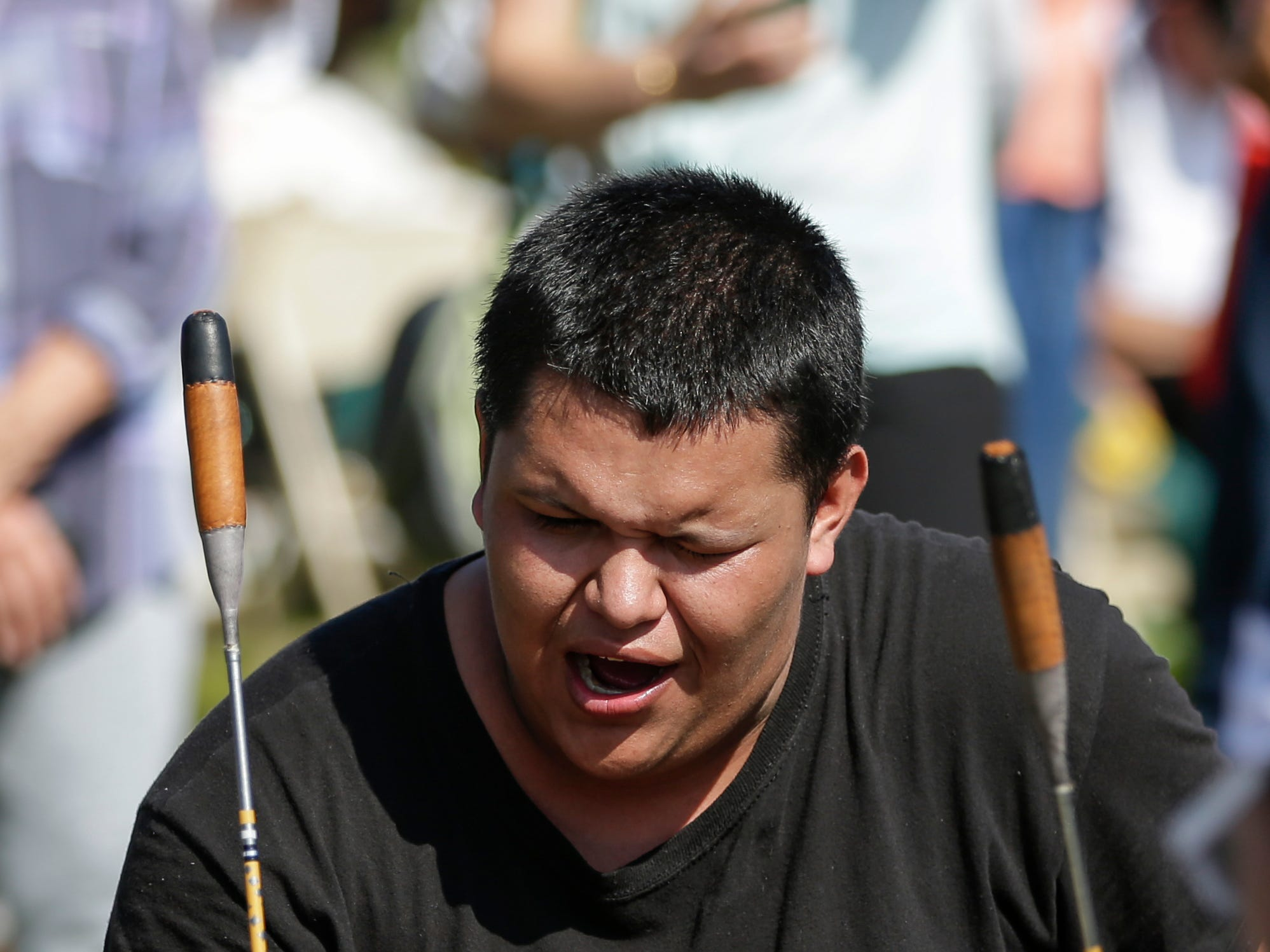 The Menominee Boys and Girls drumming circle perform during the Spirit of the Rivers monument dedication Sunday, Sept. 16, 2018, in Two Rivers, Wis.