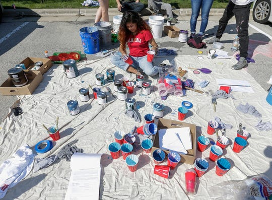 Brie Thetphasone organizes paint for the public mural at 9th and Jay Street during Art Slam Saturday, September 15, 2018, in Manitowoc, Wis. Josh Clark/USA TODAY NETWORK-Wisconsin