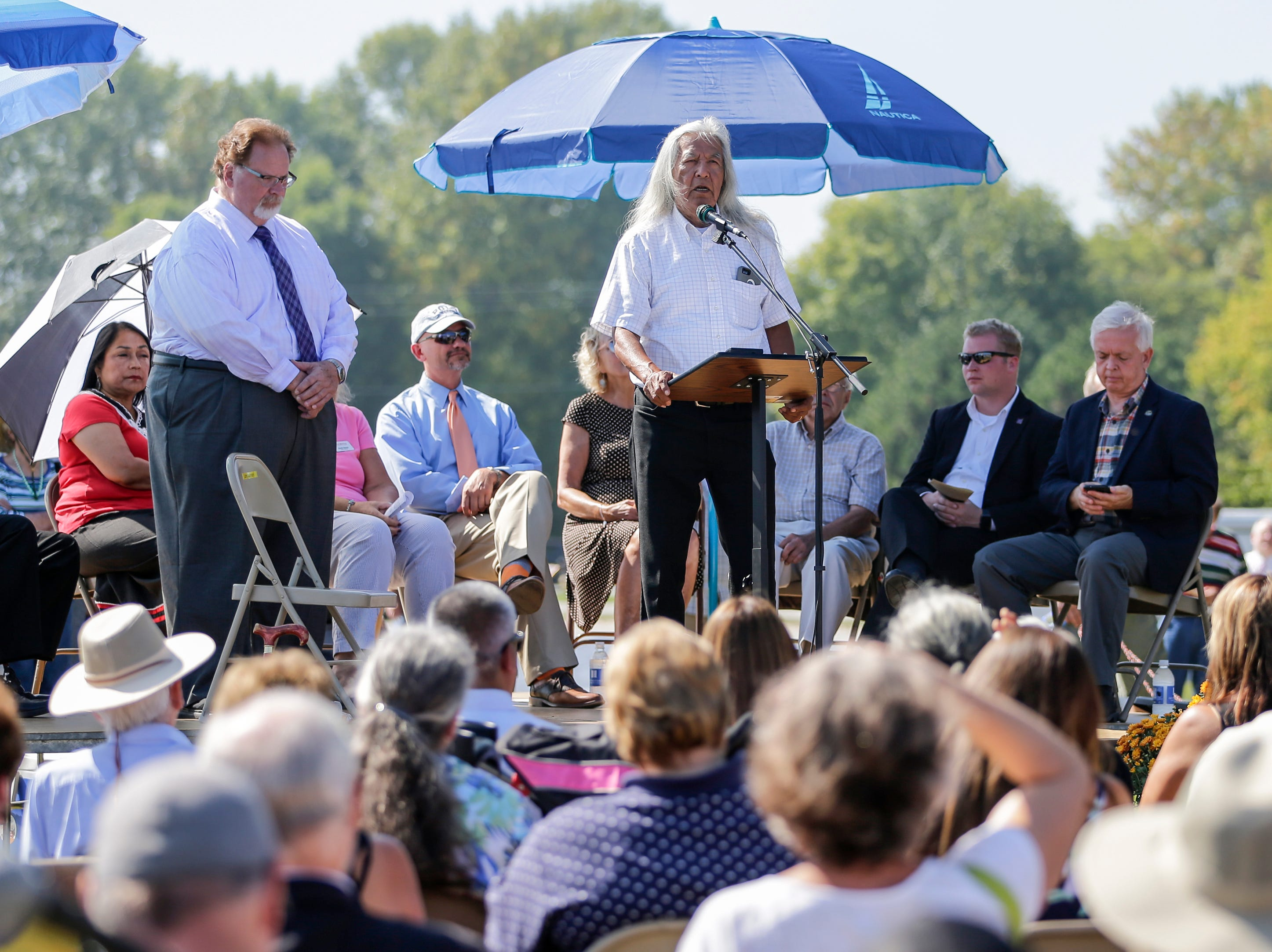 Earl Meshigaud, cultural director for Hannahville Potawatomi and great-great grandson of Chief Mishicot, opens the Spirit of the Rivers monument dedication Sunday, Sept. 16, 2018, in Two Rivers, Wis.