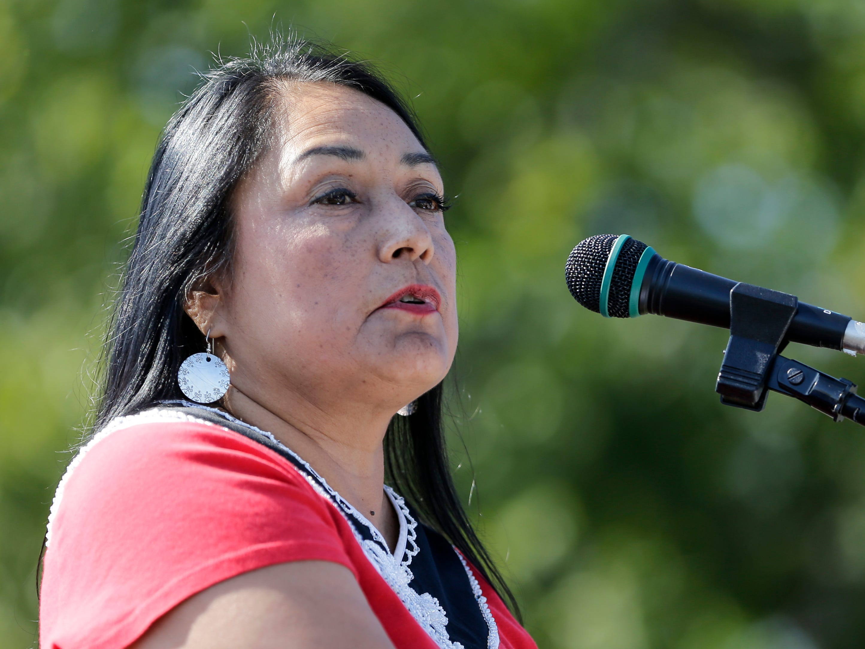 Christina Danforth, president of the Native American Finance Officers Association, speaks during the Spirit of the Rivers monument dedication Sunday, Sept. 16, 2018, in Two Rivers, Wis.