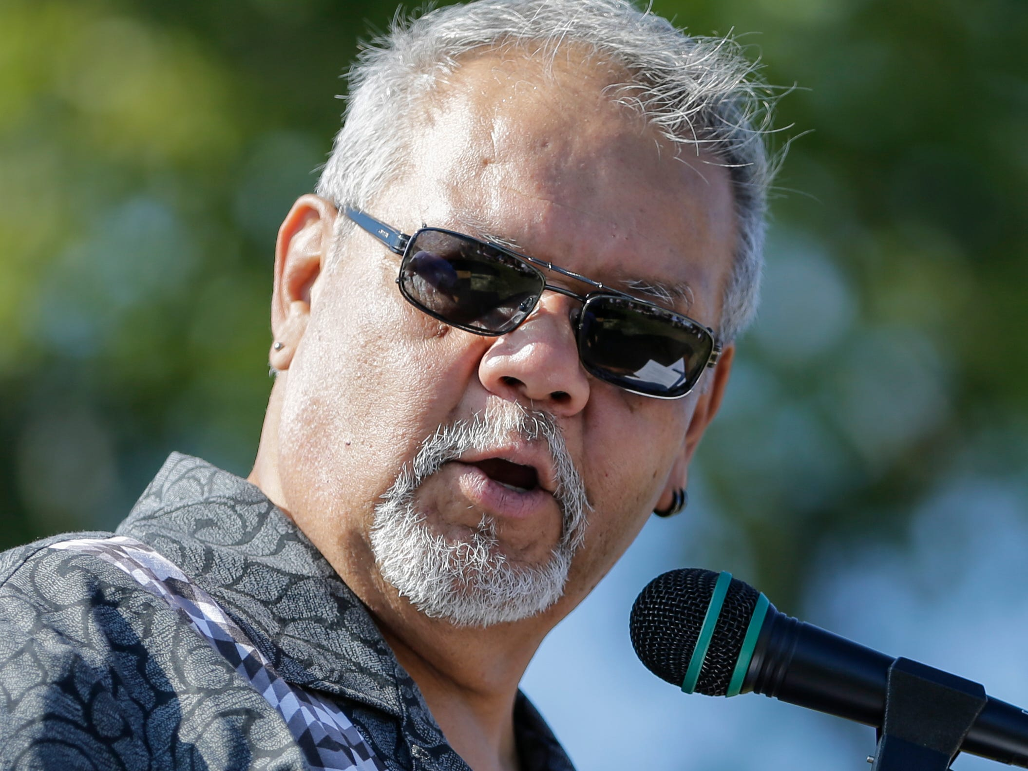 Ken Meshigaud, great-great-grandson of Chief Mishicot, speaks during the Spirit of the Rivers monument dedication Sunday, Sept. 16, 2018, in Two Rivers, Wis.