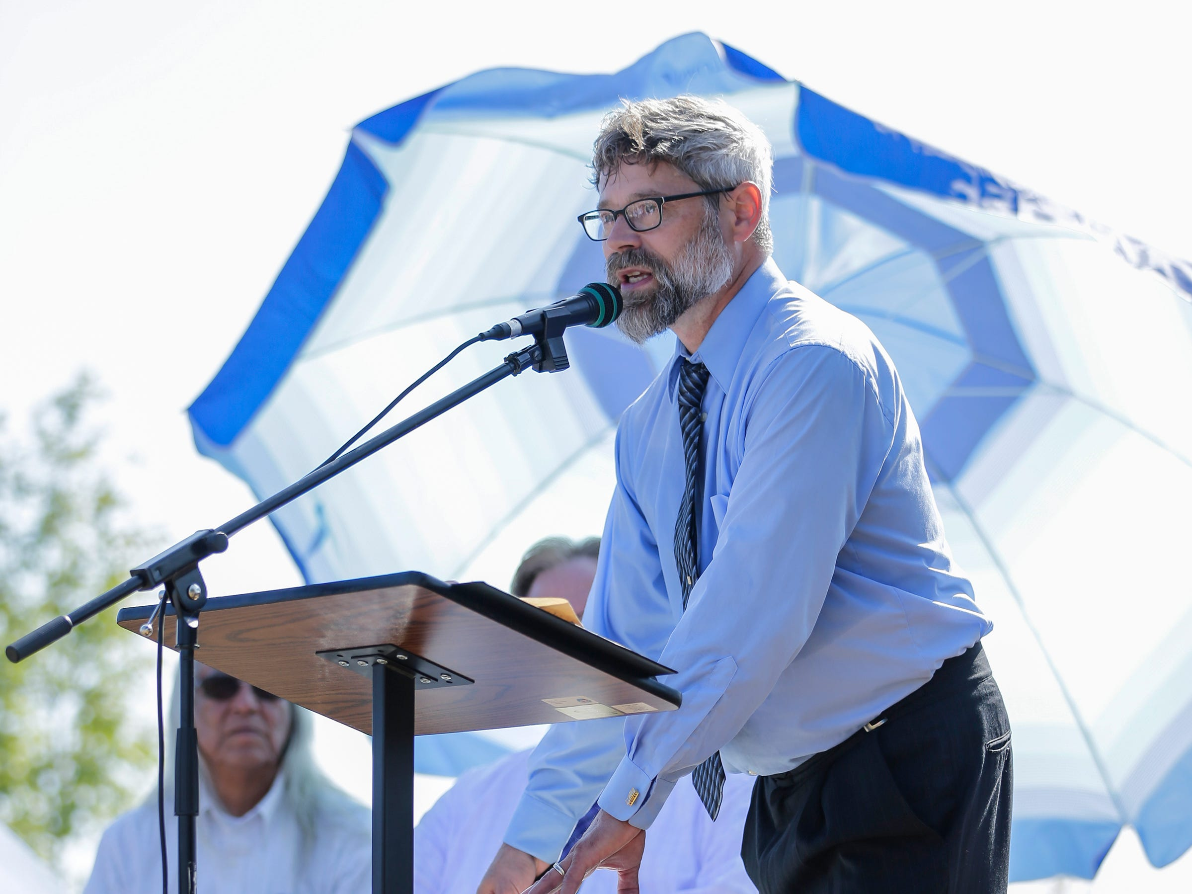 """Manitowoc public school teacher David Bourgeois sings his original song """"Spirit of the River"""" during the Spirit of the Rivers monument dedication Sunday, Sept. 16, 2018, in Two Rivers, Wis."""