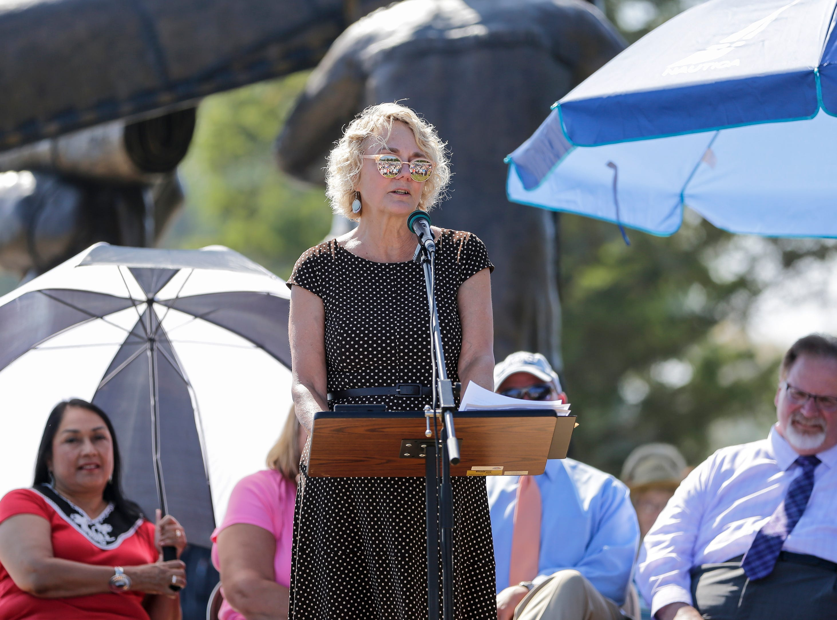 Carol Wergin, co-chair of the board of directors, speaks during the Spirit of the Rivers monument dedication Sunday, Sept. 16, 2018, in Two Rivers, Wis.