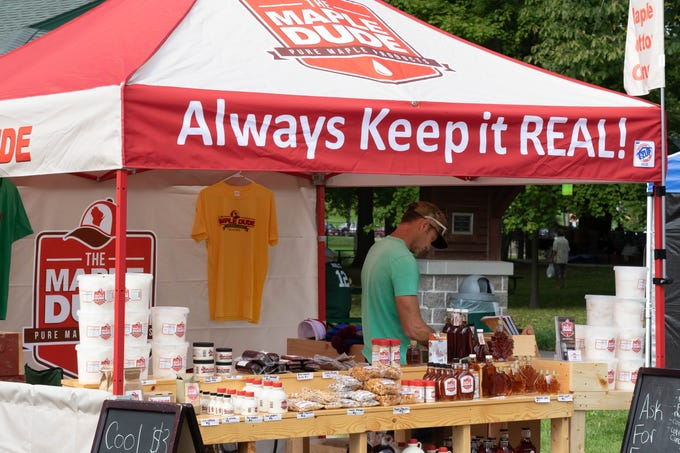 The Maple Dude sells maple syrup, apparel and other products during Maple Fall Fest on Sunday, Sept. 16, 2018, at Wildwood Park in Marshfield.