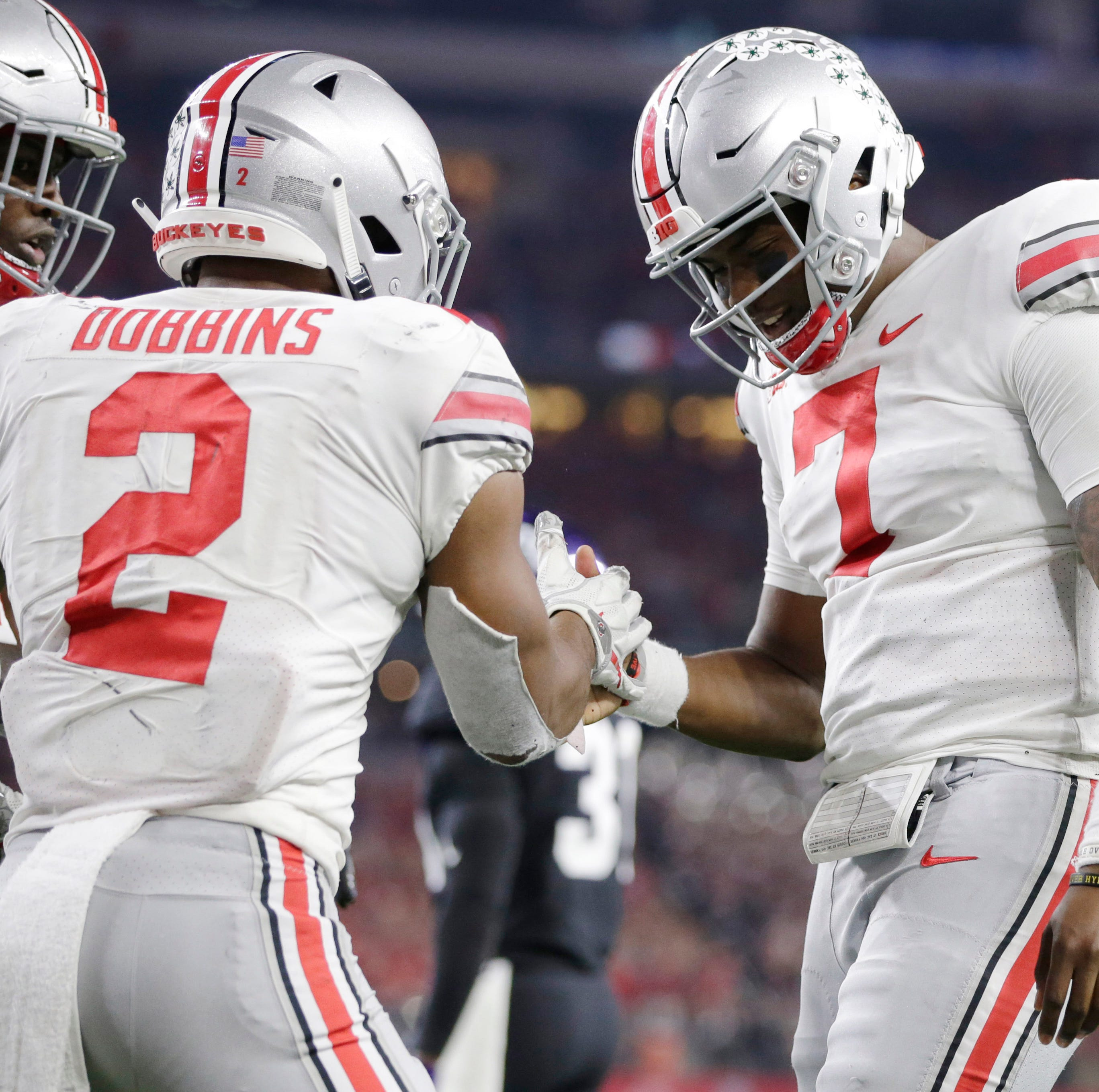 Ohio State quarterback Dwayne Haskins celebrates his fourth quarter touchdown run with tailback J.K. Dobbins.