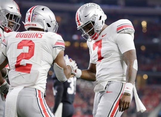 Ohio State quarterback Dwayne Haskins celebrates his fourth quarter touchdown run with tailback J.K. Dobbins.