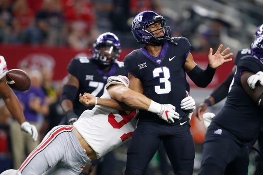 Ohio State defensive end Nick Bosa strips TCU quarterback Shawn Robinson of the ball on a fumble that was recovered in the end zone for a touchdown. Bosa would spend the second half in street clothes after getting hurt at the outset of the third quarter.